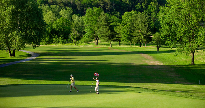 Two people playing golf at Country Club Golf Course