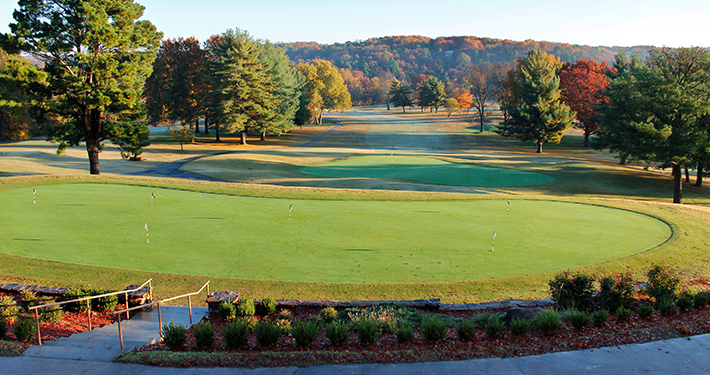 The Country Club Golf Course in the fall with colorful orange, red and green trees