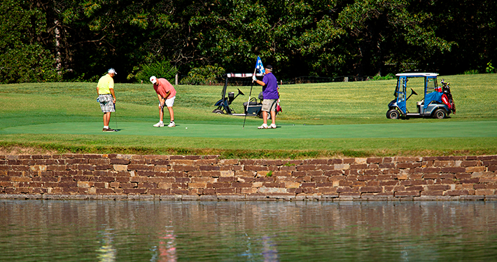 Golfers putting on a hole at Dogwood Golf Course