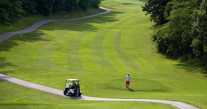 A person golfing at Highlands Golf Course