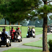 A parade of golf carts at Kingswood Golf Course