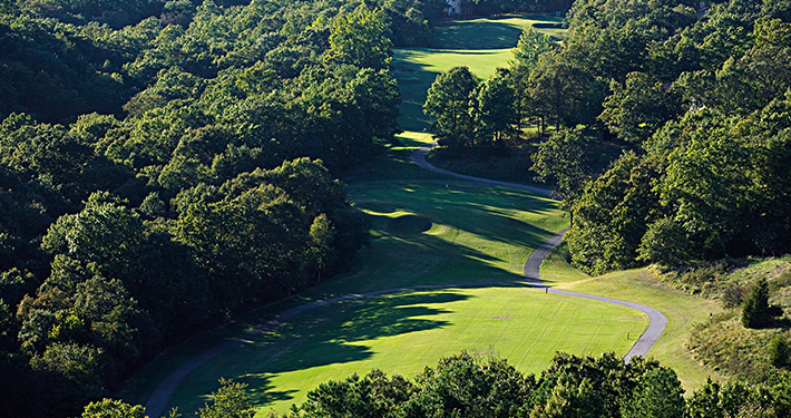 An aerial view of a cart path at Scotsdale Golf Course
