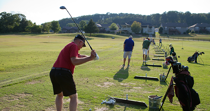 Golfers practicing drives at Tanyard Creek Practice Center