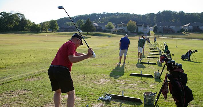 Golfers practicing drives at Tanyard Creek Practice Center