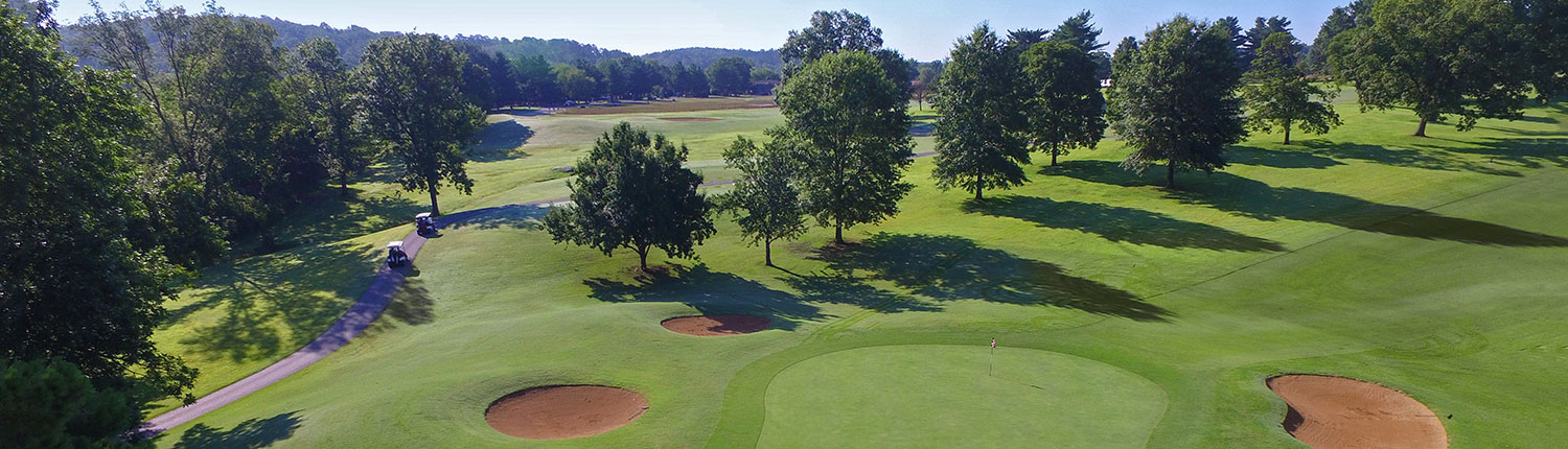 Aerial view of Country Club Golf Course with carts on a path