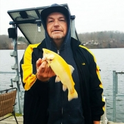 Frank holding the golden trout he caught on Lake Brittany.