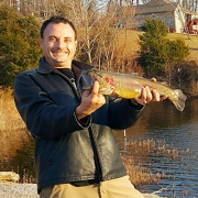 Gary Owens holding the rainbow trout he caught on Lake Brittany.