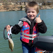 Victor and the bass he caught on Lake Ann.