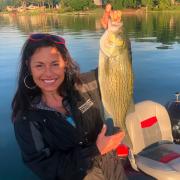 Lana Richards showing off her catch on Loch Lomond.