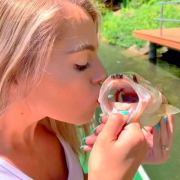 Lauryn Blansett kissing the fish she caught on Lake Ann.