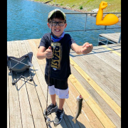 Waylon Finley and the trout he caught on Lake Brittany.